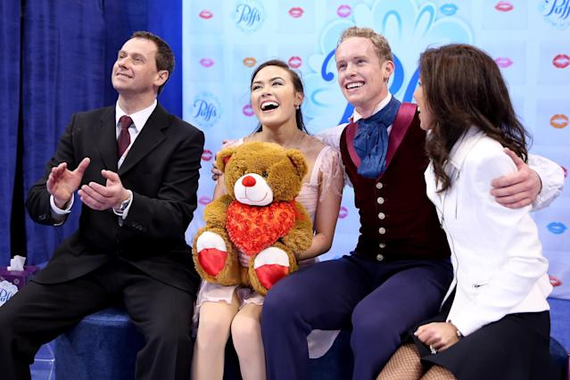 BOSTON, MA - JANUARY 11: Madison Chock and Evan Bates, with their coaches Igor Shpilband and Adrienne Lenda, celebrate in the kiss and cry after skating in the free dance during the Prudential U.S. Figure Skating Championships at TD Garden on January 11, 2014 in Boston, Massachusetts. (Photo by Matthew Stockman/Getty Images)