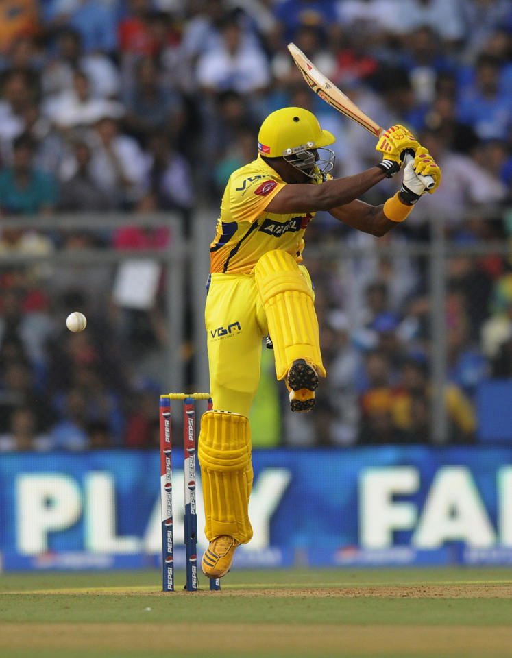 Dwayne Bravo of Chennai Super Kings gets hit by a ball during match 49 of the Pepsi Indian Premier League ( IPL) 2013  between The Mumbai Indians and the Chennai SUperkings held at the Wankhede Stadium in Mumbai on the 5th May 2013 ..Photo by Pal Pillai-IPL-SPORTZPICS  ..Use of this image is subject to the terms and conditions as outlined by the BCCI. These terms can be found by following this link:..https://ec.yimg.com/ec?url=http%3a%2f%2fwww.sportzpics.co.za%2fimage%2fI0000SoRagM2cIEc&t=1506184852&sig=8EF9aXnkNJb2c98ddz76UQ--~D