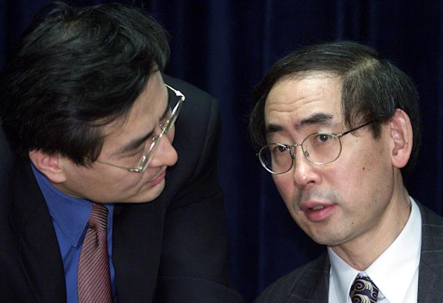 South Korean justice minister Park Sang-ki (R) at a news conference in 2002. REUTERS/Lee Jae-won