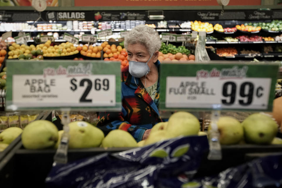 FILE - In this March 17, 2020 file photo, Carmen Zamora shops at Northgate González Market in Santa Ana, Calif., during an early-hour shopping time for those over 65 and the disabled. Taxpayers will pay restaurants to make three meals a day for California's millions of seniors during the coronavirus pandemic, Gov. Gavin Newsom announced Friday, April 24, 2020, putting the industry back to work and generating sales tax collections for cash-strapped local governments. California has about 5.7 million people 65 and older, but not all of them will be eligible. Newsom said seniors must have either been exposed to the virus, have a high risk for potential exposure or a compromised immune system. (AP Photo/Chris Carlson)
