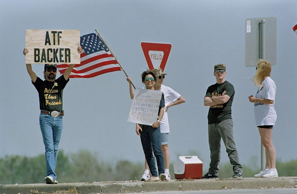 Four people demonstrate in favor of the Bureau of Alcohol, Tobacco and Firearms agents near the Branch Davidian compound outside Waco, Texas, March 27, 1993. The ATF has been criticized for its failed attempt to serve a search warrant on the cult compound on Feb. 28. Four agents were killed and the standoff enters its fifth week Sunday.