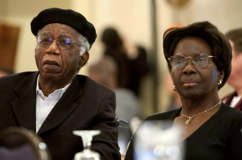 "This 2010 photo provided by Brown University shows Chinua Achebe, left, with his wife Christie Achebe on campus in Providence, R.I. Achebe, an internationally celebrated Nigerian author, statesman and dissident, has died at age 82. Achebe's 1958 novel, ""Things Fall Apart,"" is widely regarded as the first major work of modern African fiction and inspired others to tell the continent's story through the eyes of those who lived there. (AP Photo/Brown University, Mike Cohea)"