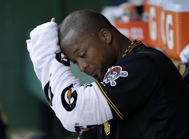 Pittsburgh Pirates starting pitcher Francisco Liriano wipes his head with his wrapped pitching arm while sitting in the dugout in the fourth inning of Game 3 of a National League division baseball series against the St. Louis Cardinals on Sunday, Oct. 6, 2013 in Pittsburgh. (AP Photo/Gene J. Puskar)