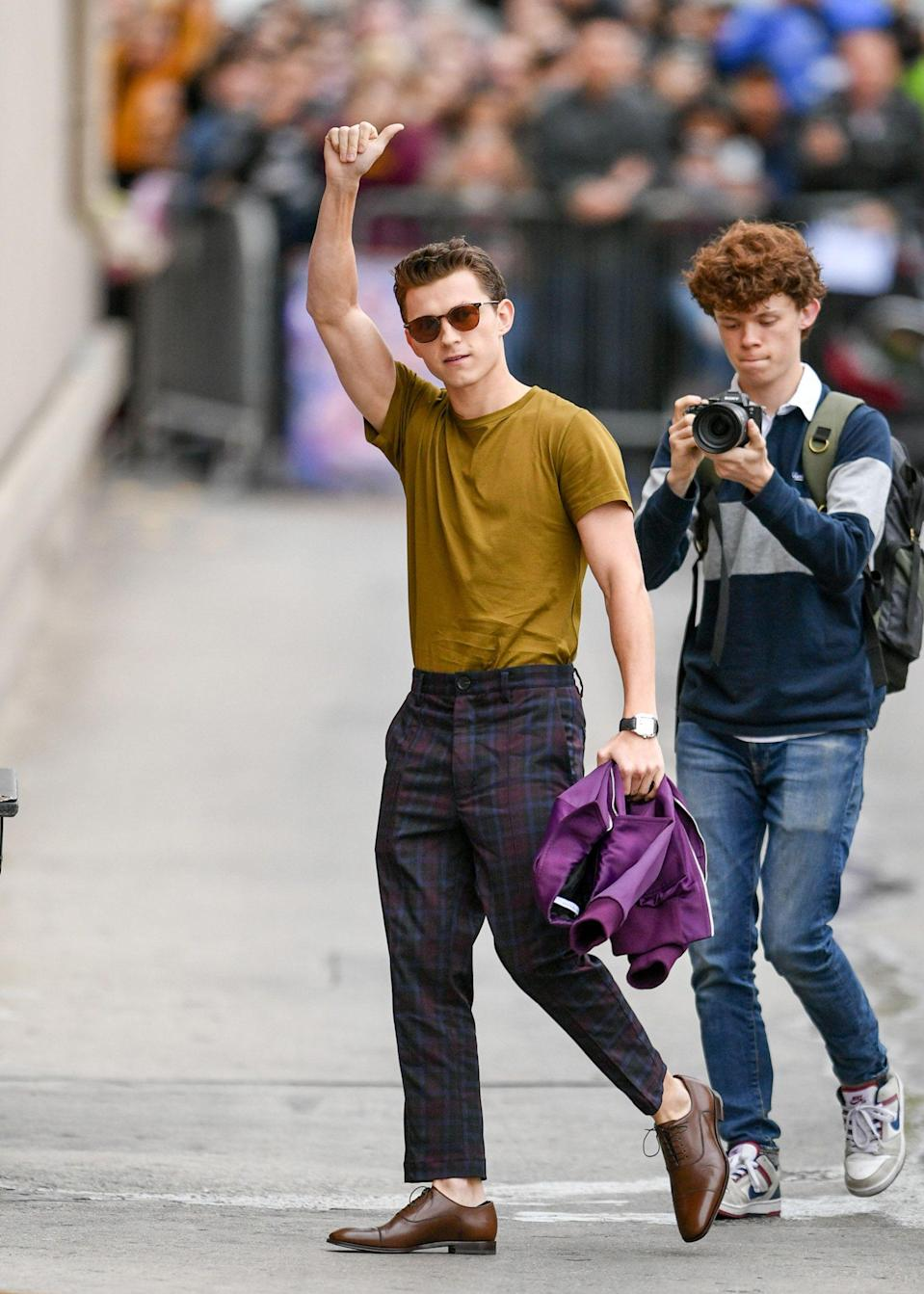 """<p>If Tom Holland had it his way, he'd be offline and living privately. """"But I think Marvel and Sony would shit their pants if I said goodbye to all of my followers,"""" the star told us in his <a href=""""https://www.esquire.com/entertainment/movies/a35401608/tom-holland-spider-man-3-cherry-cover-story/"""" rel=""""nofollow noopener"""" target=""""_blank"""" data-ylk=""""slk:Esquire cover interview"""" class=""""link rapid-noclick-resp""""><em>Esquire</em> cover interview</a> this winter. That's a healthy amount of pressure for certain, but in the (very remote) chance that those contracts ever dry up, it still feels like a good idea to round up some our favorite candid snaps of Tom Holland, well, being Tom Holland. And what better occasion than the star's 25th birthday? From fan festivals across the globe to family meet ups back in England, here are 35 photos of the UK actor through the years. </p>"""