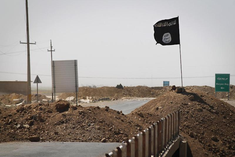 Islamic State flag is seen at the frontline of fighting on the road between Kirkuk and Tikrit, Iraq, on September 11, 2014