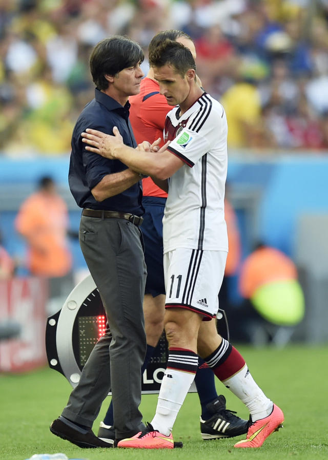 Germany's head coach Joachim Loew greets Germany's Miroslav Klose after he was substituted during the World Cup quarterfinal soccer match between Germany and France at the Maracana Stadium in Rio de Janeiro, Brazil, Friday, July 4, 2014. (AP Photo/Martin Meissner)