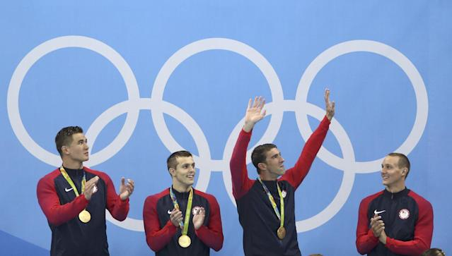 <p>Michael Phelps (USA) of USA, Caeleb Dressel (USA) of USA, Nathan Adrian (USA) of USA and Ryan Held (USA) of USA pose with their gold medals. REUTERS/Marcos Brindicci </p>
