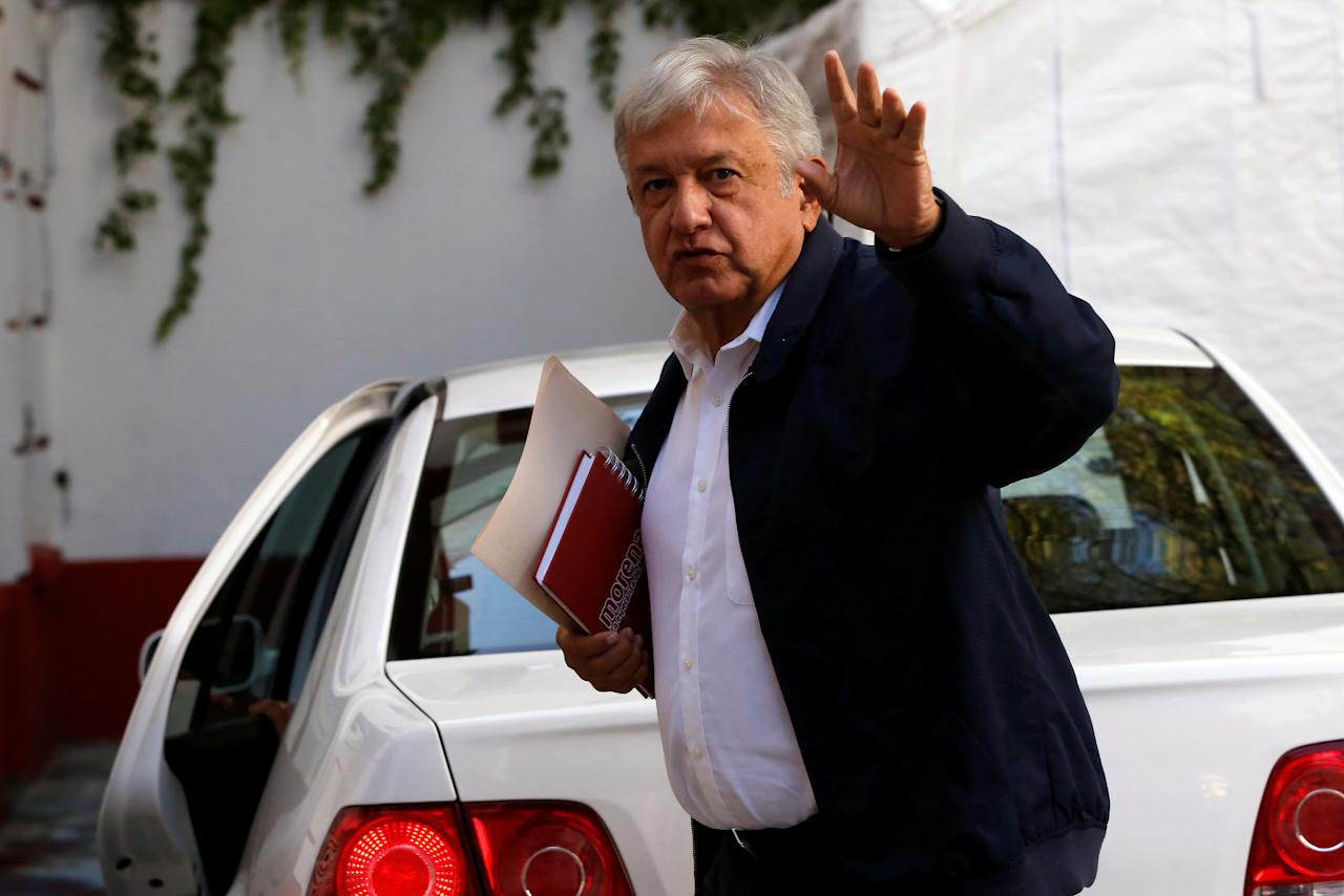 Mexico's president-elect Andres Manuel Lopez Obrador waves while arriving to his campaign headquarters for a news conference in Mexico City, Mexico July 22, 2018. REUTERS/Ginnette Riquelme