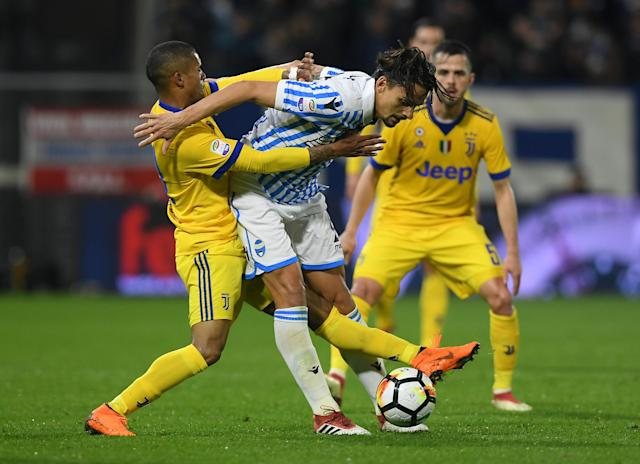 Soccer Football - Serie A - SPAL vs Juventus - Paolo Mazza, Ferrara, Italy - March 17, 2018 Juventus' Douglas Costa in action with Spal's Felipe REUTERS/Alberto Lingria