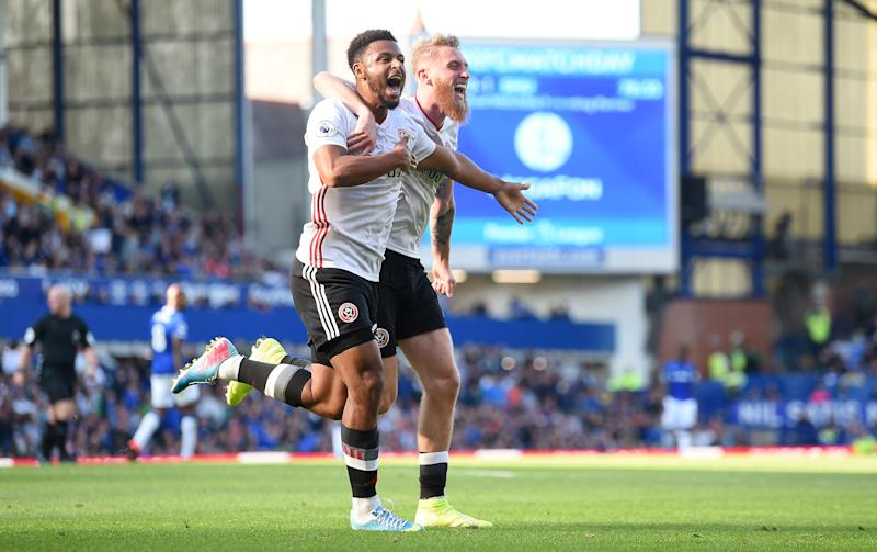 LIVERPOOL, ENGLAND - SEPTEMBER 21: Lys Mousset of Sheffield United celebrates after scoring his team's second goal with Oliver McBurnie during the Premier League match between Everton FC and Sheffield United at Goodison Park on September 21, 2019 in Liverpool, United Kingdom. (Photo by Nathan Stirk/Getty Images)