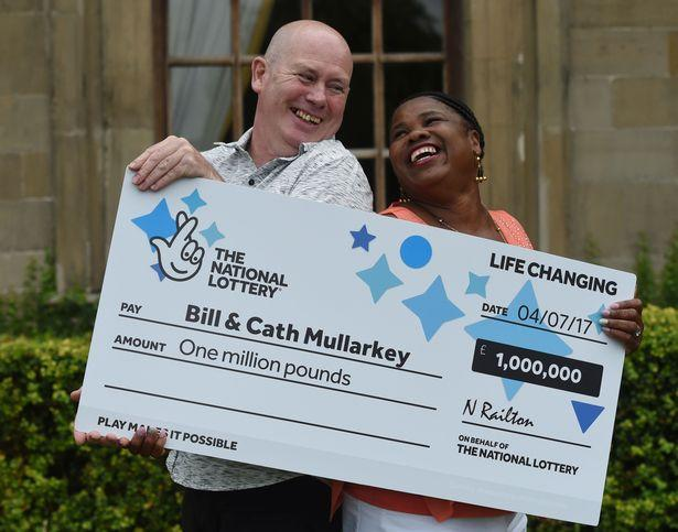 The couple pictured with their lottery cheque in 2015. (Reach)