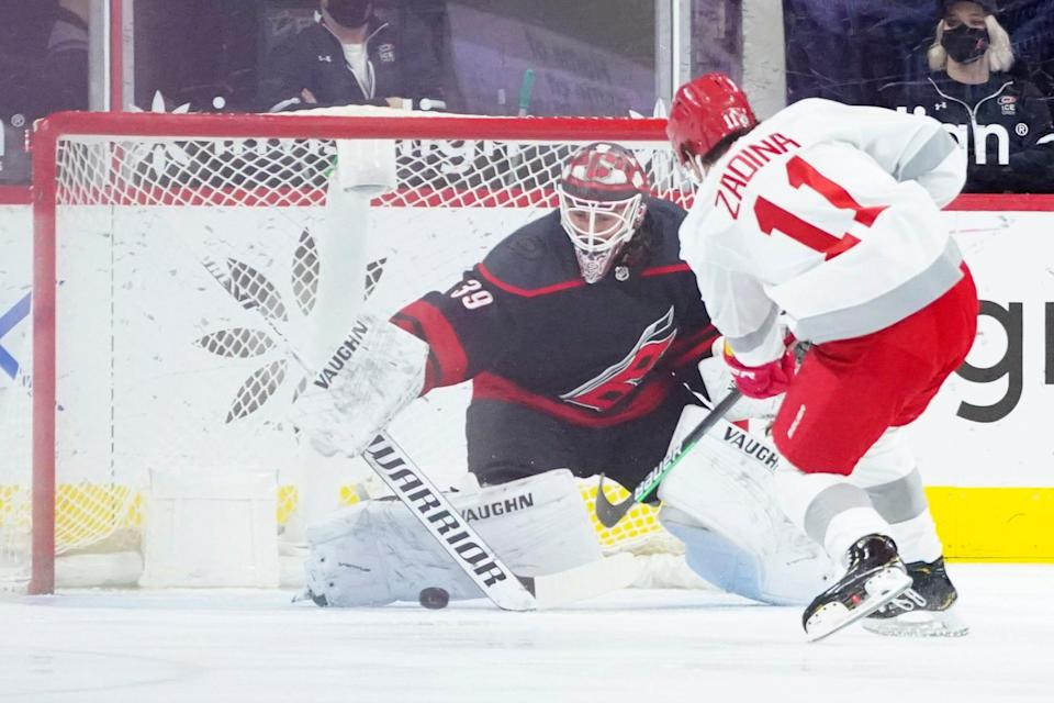 Hurricanes goaltender Alex Nedeljkovic stops a shot by Red Wings right wing Filip Zadina during the first period on Thursday, March 4, 2021, in Raleigh, North Carolina.
