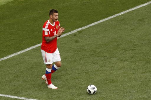 Russia's Fyodor Smolov applauds during the group A match between Russia and Saudi Arabia which opens the 2018 soccer World Cup at the Luzhniki stadium in Moscow, Russia, Thursday, June 14, 2018. (AP Photo/Darko Bandic)