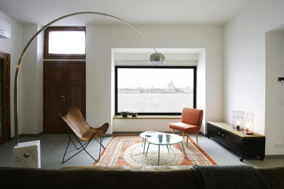 """Yes, the design of this two-bedroom, three-bathroom apartment is stunning on its own, but its simplicity serves to showcase the home's best asset: its views. This Airbnb has uninterrupted, picture-perfect views of the Basilica di Santa Maria della Salute and the San Marco waterfront thanks to its location on Giudecca. But just because you're on a periphery island doesn't mean you're removed from the action: The apartment is near <a href=""""http://www.treoci.org/index.php/it/"""" rel=""""nofollow noopener"""" target=""""_blank"""" data-ylk=""""slk:Casa dei Tre Oci"""" class=""""link rapid-noclick-resp"""">Casa dei Tre Oci</a>, a contemporary photography museum <a href=""""https://www.cntraveler.com/story/the-locals-guide-to-venice?mbid=synd_yahoo_rss"""" rel=""""nofollow noopener"""" target=""""_blank"""" data-ylk=""""slk:locals love"""" class=""""link rapid-noclick-resp"""">locals love</a>, and is only a 10-minute water taxi ride away from central Venice. $230, Airbnb (Starting Price). <a href=""""https://www.airbnb.com/rooms/238064244"""" rel=""""nofollow noopener"""" target=""""_blank"""" data-ylk=""""slk:Get it now!"""" class=""""link rapid-noclick-resp"""">Get it now!</a>"""