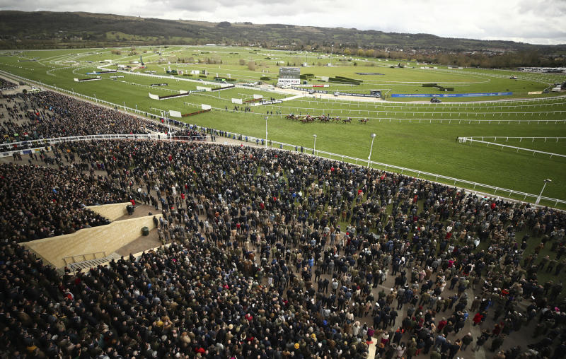 A general view from the Grand Stand of the Ballymore Novices' Hurdle the Cheltenham Horse Racing Festival at Cheltenham Racecourse, England, Wednesday March 11, 2020. (Tim Goode/PA via AP)