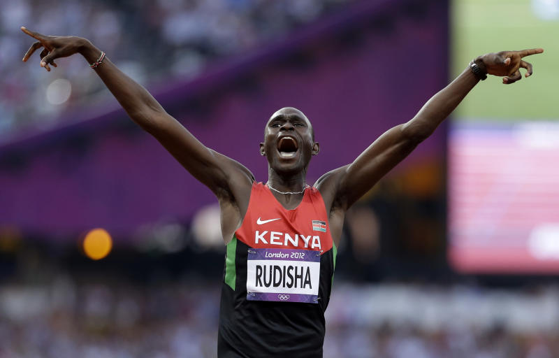 Kenya's David Lekuta Rudisha celebrates his win in the men's 800-meter final during the athletics in the Olympic Stadium at the 2012 Summer Olympics, London, Thursday, Aug. 9, 2012. Rudisha set a new world record with a time of 1:40.91. (AP Photo/Anja Niedringhaus)