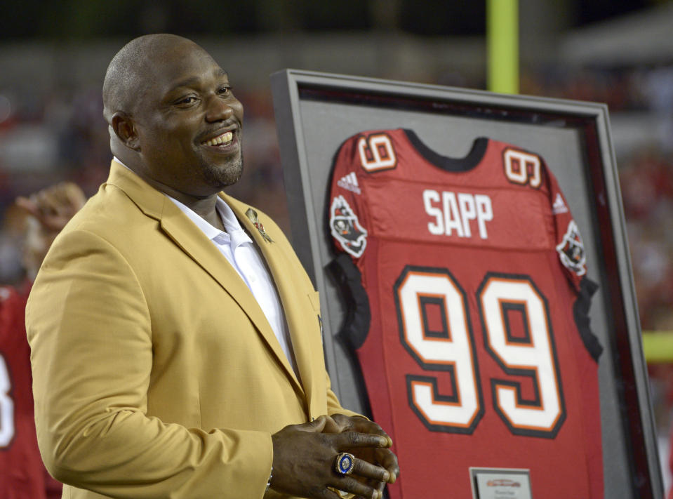 FILE - In this Nov. 11, 2013, file photo, former Tampa Bay Buccaneers player Warren Sapp smiles after being inducted in the Ring of Honor ceremony during halftime in an NFL football game between the Tampa Bay Buccaneers and the Miami Dolphins in Tampa, Fla. Hall of Famer Warren Sapp wishes the Buccaneers could pack the stands for the first Super Bowl played in a host team's home stadium. (AP Photo/Phelan M. Ebenhack, File)