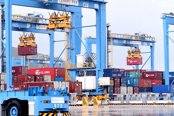 QINGDAO, CHINA - SEPTEMBER 19, 2021 - Bridge cranes load and unload foreign trade containers automatically at Qingdao Port automation Terminal in Qingdao, East China's Shandong Province, Sept. 19, 2021. (Photo credit should read Yu Fangping / Costfoto/Barcroft Media via Getty Images)