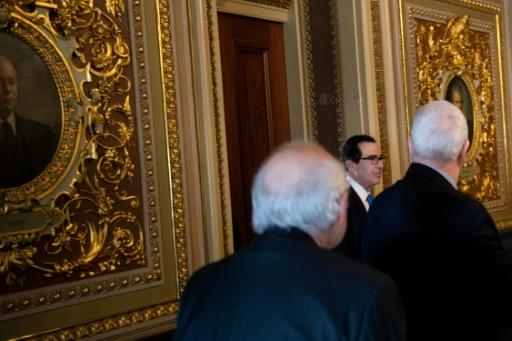 US Treasury Secretary Steven Mnuchin leaves a meeting in the US Capitol as negotiations on a rescue package for Americans and their economy ravaged by the coronavirus pandemic continue in Congress