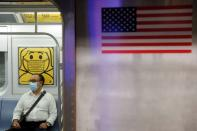 FILE PHOTO: A commuter wears a mask while riding the subway as cases of the infectious coronavirus Delta variant continue to rise in New York City, New York