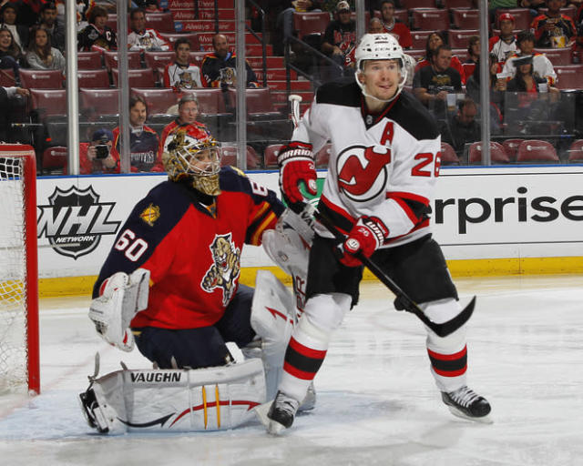 SUNRISE, FL - APRIL 21: Patrik Elias #26 of the New Jersey Devils positions himself in front of goaltender Jose Theodore #60 of the Florida Panthers to attempt to redirect the puck in Game Five of the Eastern Conference Quarterfinals during the 2012 NHL Stanley Cup Playoffs at the BankAtlantic Center on April 21, 2012 in Sunrise, Florida. The Panthers defeated the Devils 3-0. (Photo by Joel Auerbach/Getty Images)