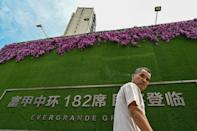 Analysts warn the Evergrande fallout could lead to the bursting of a bubble that has been building for more than two decades (AFP/Hector RETAMAL)