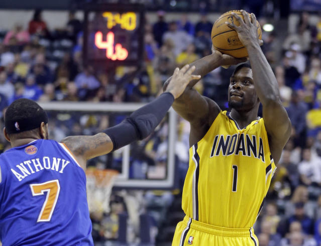 Indiana Pacers guard Lance Stephenson shoots over New York Knicks forward Carmelo Anthony during the second half of an NBA basketball game in Indianapolis, Thursday, Jan. 16, 2014. The Pacers defeated the Knicks 117-89. (AP Photo/Michael Conroy)