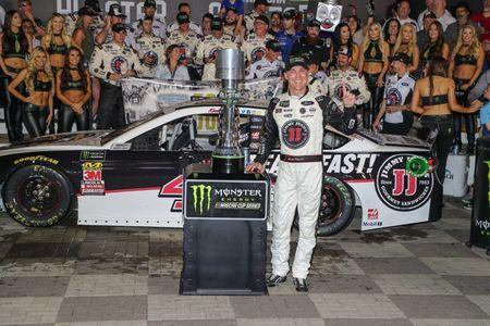 May 19, 2018; Concord, NC, USA; Monster Energy NASCAR Cup Series driver Kevin Harvick (4) celebrates after his million dollar win during the NASCAR Cup Series All-Star Open at Charlotte Motor Speedway. Mandatory Credit: Jim Dedmon-USA TODAY Sports