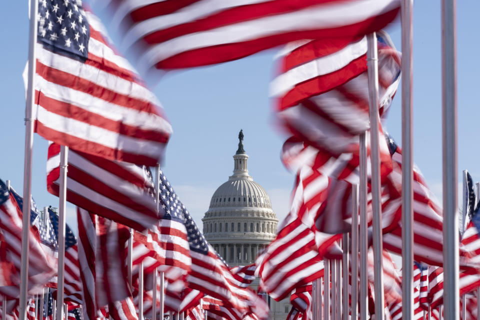 The U.S. Capitol is seen between flags placed on the National Mall ahead of the inauguration of President-elect Joe Biden and Vice President-elect Kamala Harris, Monday, Jan. 18, 2021, in Washington. (AP Photo/Alex Brandon)