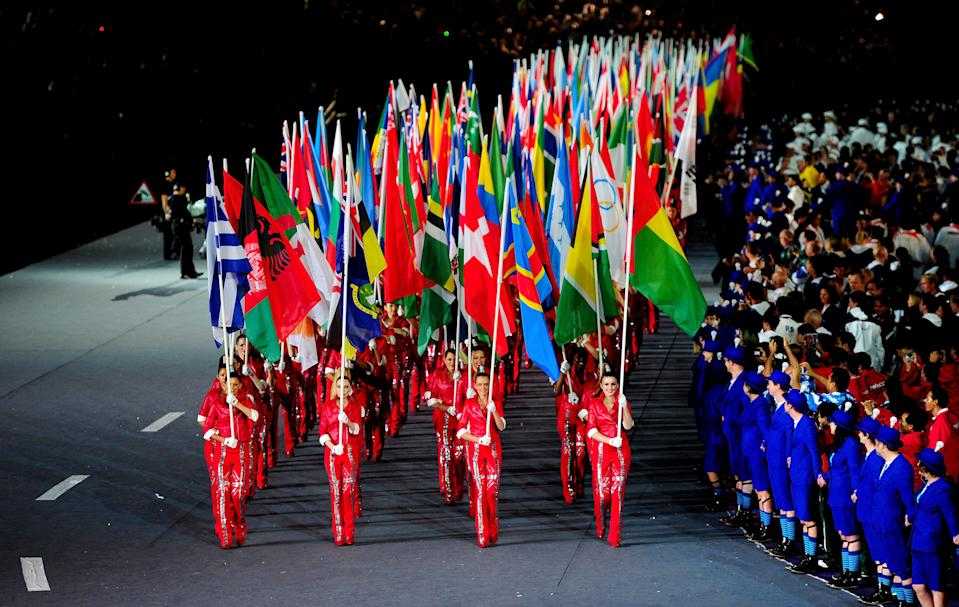 The flags of the competing nations are paraded through the stadium during the Closing Ceremony on Day 16 of the London 2012 Olympic Games at Olympic Stadium on August 12, 2012 in London, England. (Photo by Mike Hewitt/Getty Images)