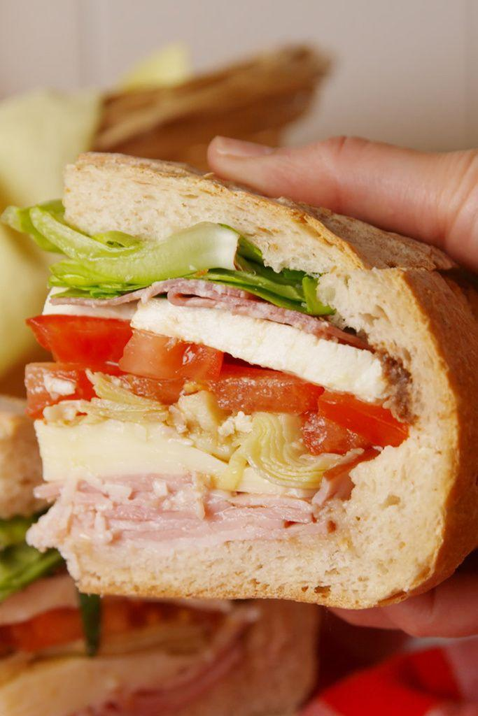 """<p>♫ You can plan a pretty picnic but you can't predict the weather...♫</p><p>Get the recipe from <a href=""""https://www.delish.com/cooking/recipe-ideas/recipes/a52811/italian-stuffed-picnic-loaf/"""" rel=""""nofollow noopener"""" target=""""_blank"""" data-ylk=""""slk:Delish"""" class=""""link rapid-noclick-resp"""">Delish</a>.</p>"""