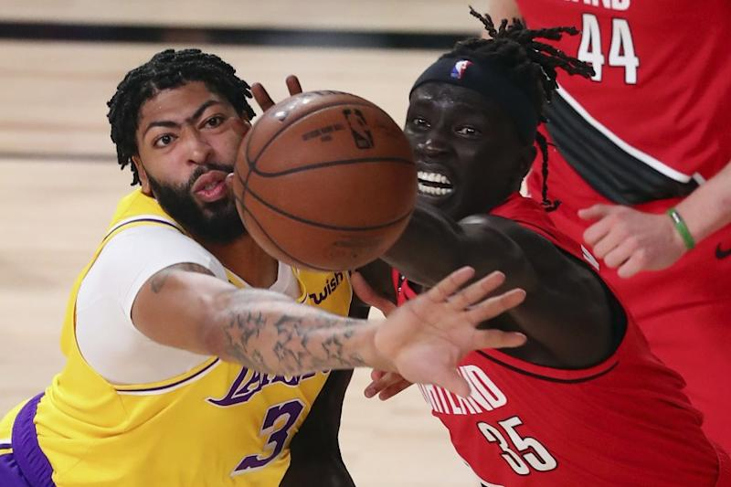 Lakers forward Anthony Davis, left, and Portland Trail Blazers forward Wenyen Gabriel battle for the ball during Game 2.