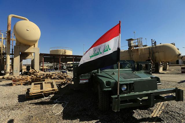 <p>An Iraqi flag is seen on a military vehicle at an oil field in Dibis area on the outskirts of Kirkuk, Iraq, Oct. 17, 2017. (Photo: Alaa Al-Marjani/Reuters) </p>