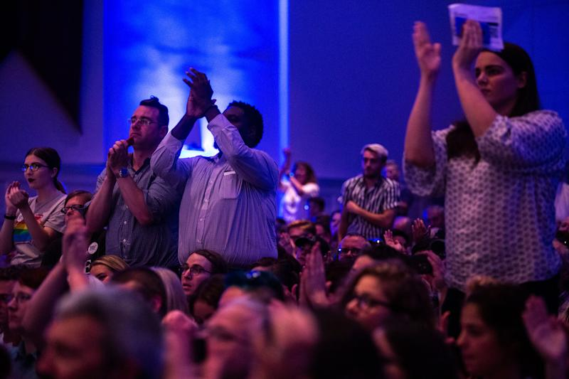 Members of the crowd cheer during the LGBTQ Presidential Forum, sponsored by GLAAD, One Iowa, The Gazette, and The Advocate, Friday, Sept., 20, 2019, at Sinclair Auditorium on the Coe College campus in Cedar Rapids, Iowa.