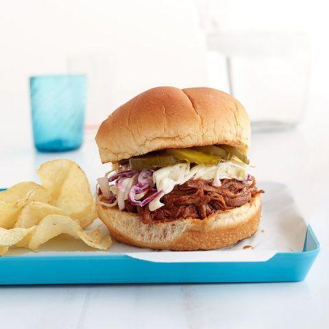 """<p>The secret sauce to this barbecue brisket sandwich? The addition of crisp, tangy cabbage slaw on top. </p><p><strong><em><a href=""""https://www.womansday.com/food-recipes/food-drinks/recipes/a12869/bbq-brisket-sandwiches-quick-slaw-recipe-wdy0714/"""" rel=""""nofollow noopener"""" target=""""_blank"""" data-ylk=""""slk:Get the recipe for BBQ Brisket Sandwiches with Quick Slaw"""" class=""""link rapid-noclick-resp"""">Get the recipe for BBQ Brisket Sandwiches with Quick Slaw</a></em></strong><strong>. </strong></p>"""