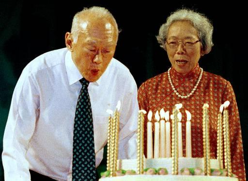 Singapore's Senior Minister Lee Kuan Yew blows out candles on his birthday cake as his wife Kwa Geok Choo looks on at a ceremony held to celebrate his 77th birthday and the launch of his new book in Singapore Saturday, Sept. 16, 2000. Lee wrote in his new book that he believes that Singapore could disappear as a sovereign state if foreign powers fail to maintain stable relations with each other. (AP Photo/Edward Wray)