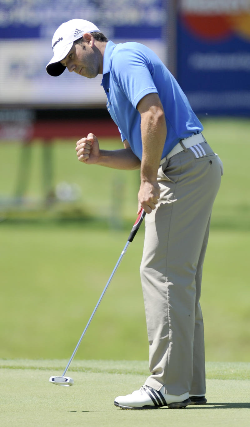 Sergio Garcia, of Spain, reacts after making a birdie on the fifth hole during the first round of the Byron Nelson Championship golf tournament in Irving, Texas, Thursday, May 26, 2011. (AP Photo/Matt Strasen)