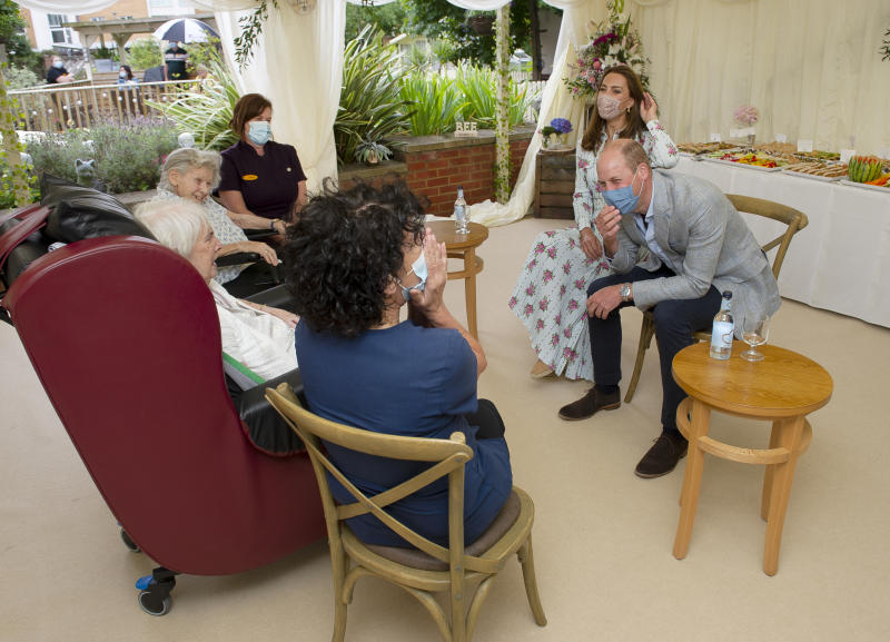 CARDIFF, WALES - AUGUST 05: Prince William, Duke of Cambridge and Catherine, Duchess of Cambridge react as they were told they aren't good at online bingo by resident Joan Drew Smith (in white blouse) at the Shire Hall Care Home, where they spoke to some of the home's staff, residents and their family members on August 5, 2020 in Cardiff, Wales. In May, The Duke and Duchess joined staff and residents from Shire Hall via video call, and took their turn as guest bingo callers for a game in the home's cinema. (Photo by Jonathan Buckmaster - WPA Pool/Getty Images)