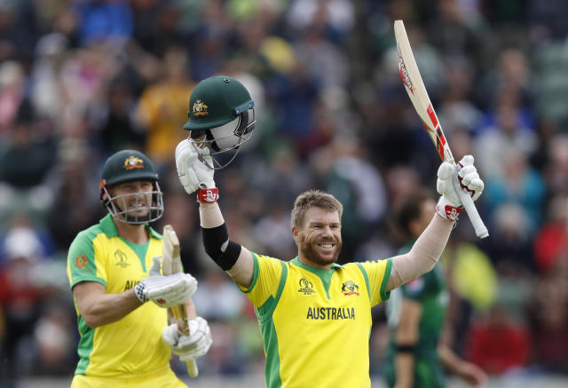 Australia's David Warner, right, celebrates after getting 100 runs not out during the Cricket World Cup match between Australia and Pakistan at the County Ground in Taunton, south west England, Wednesday, June 12, 2019. (AP Photo/Alastair Grant)