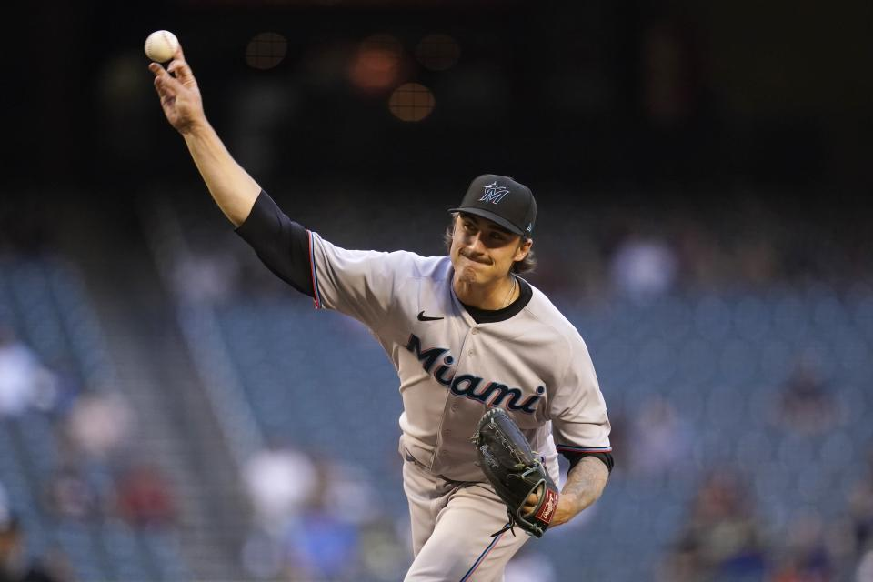 Miami Marlins starting pitcher Jordan Holloway throws a pitch against the Arizona Diamondbacks during the first inning of a baseball game Monday, May 10, 2021, in Phoenix. (AP Photo/Ross D. Franklin)
