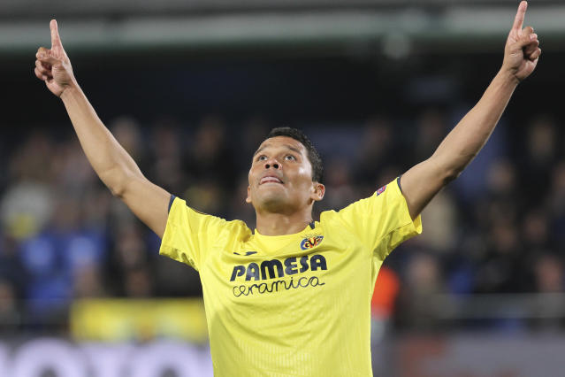 Villarreal's Carlos Bacca celebrates after scoring his side's second goal during a Europa League round of 16, 2nd leg soccer match between Villarreal and Zenit St.Petersburg at the Ceramica stadium in Villarreal, Spain, Thursday March 14, 2019. (AP Photo/Alberto Saiz)