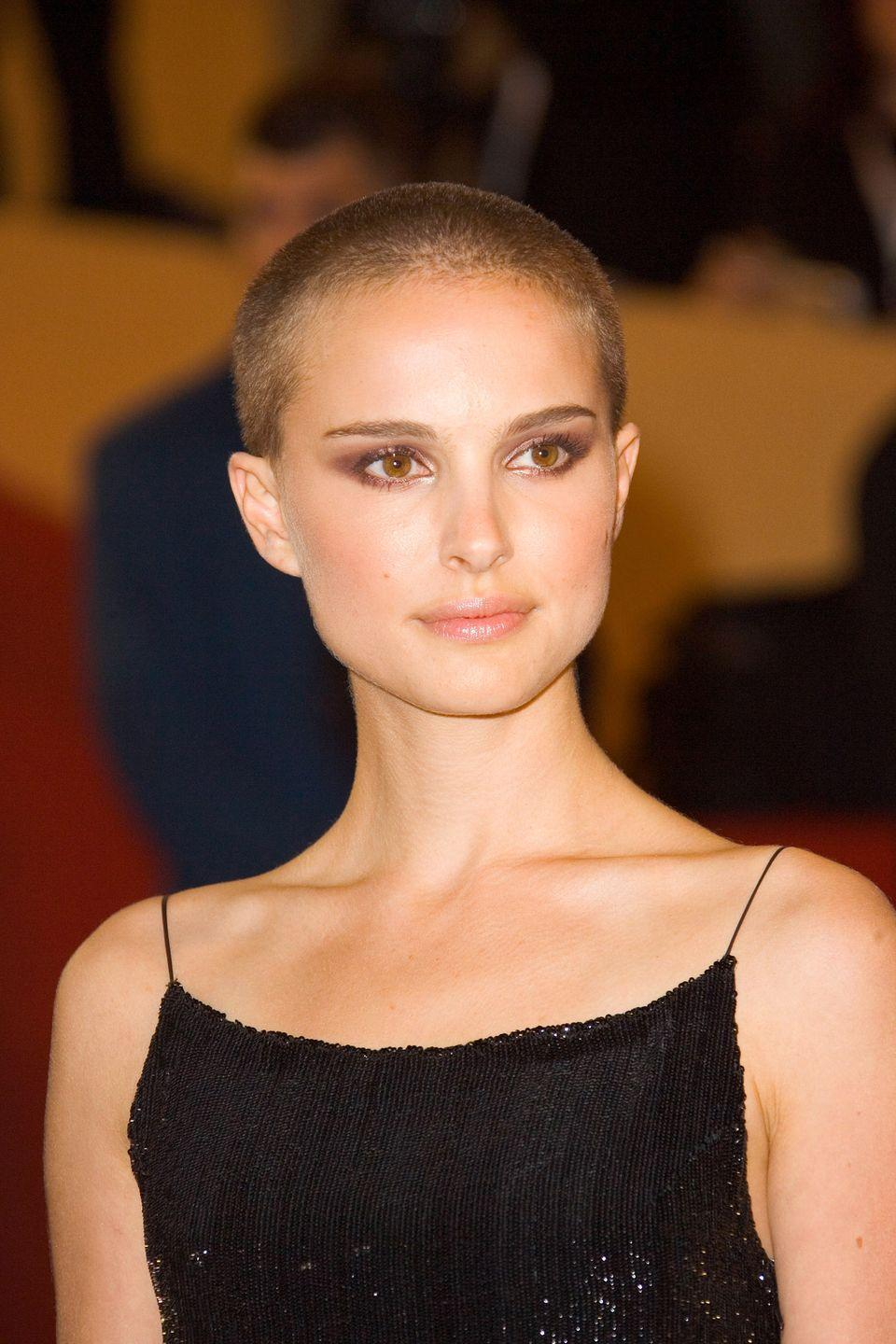 <p>Natalie Portman temporarily sacrificed her signature long brunette locks for a starring role in <em>V for Vendetta</em>. The actress ended up getting the super short buzz on camera while filming a dramatic torture scene.</p>