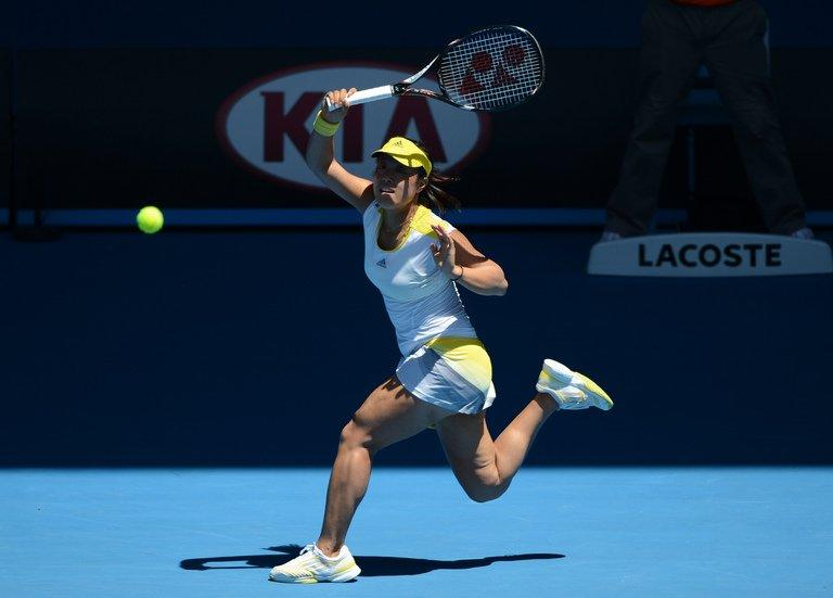 Ayumi Morita of Japan plays a return at the Australian Open tennis tournament in Melbourne on January 19, 2013