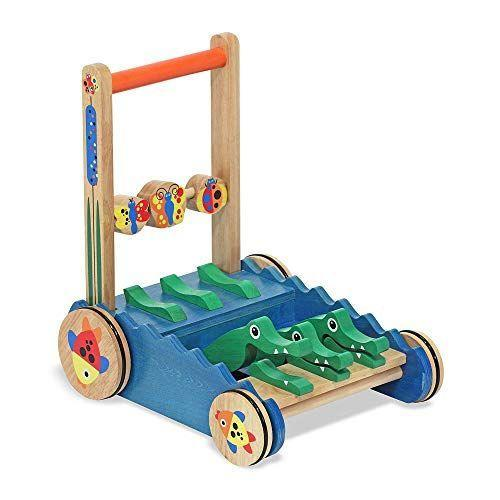 """<p><strong>Melissa & Doug</strong></p><p>amazon.com</p><p><strong>$39.19</strong></p><p><a href=""""https://www.amazon.com/dp/B000GZGE3Q?tag=syn-yahoo-20&ascsubtag=%5Bartid%7C10055.g.5152%5Bsrc%7Cyahoo-us"""" rel=""""nofollow noopener"""" target=""""_blank"""" data-ylk=""""slk:Shop Now"""" class=""""link rapid-noclick-resp"""">Shop Now</a></p><p>As your child pushes this wooden walker around, <strong>the alligators snap their jaws</strong> with a satisfying clacking sound. It's perfect for kids who are practicing their first steps.</p>"""