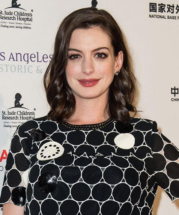 <br>Despite a couple of dalliances, Anne Hathaway has pretty much always remained loyal to her natural brunette hue...
