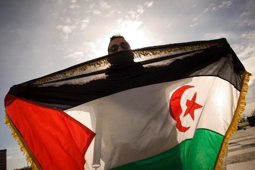 A pro-Sahrawi activist displays a Western Sahara flag as he takes part in a demonstration on December 4, 2010 during a Moroccan fair in Malaga, southern Spain to condemn a deadly Moroccan raid on a camp in the disputed Western Sahara