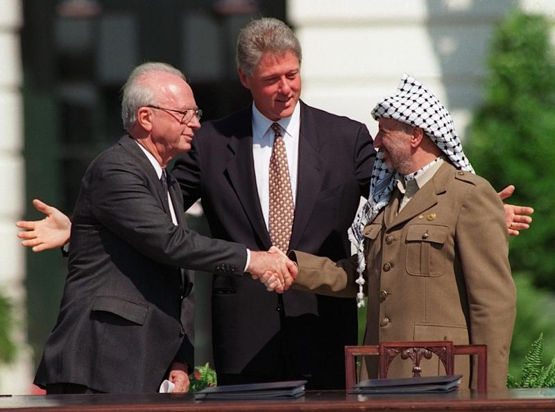 FILE - This is a Sept,  13, 1993 file photo of President Clinton presides over ceremonies marking the signing of the 1993 peace accord between Israel and the Palestinians on the White House lawn with Israeli Prime Minister Yitzhak Rabin, left, and PLO chairman Yasser Arafat, right. (AP Photo/Ron Edmonds, File)