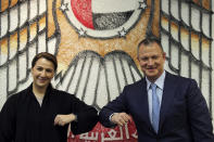 UAE Minister of State for Food and Water Security Mariam al-Muhairi, left, and Erel Margalit, founder and chairman of Jerusalem Venture Partners, touch elbows after their meeting at the headquarter of the Government Accelerators in Dubai, United Arab Emirates, Tuesday, Oct. 27, 2020. Another plane full of Israeli business people excited about their newfound access to the UAE has touched down in Dubai this week. It's the latest whirlwind trip seeking to cash in on a U.S.-brokered deal to normalize relations between the countries. (AP Photo/Kamran Jebreili)