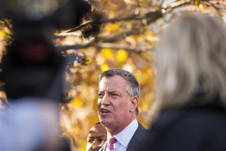 Democratic New York City mayoral candidate Bill de Blasio speaks to the media outside campaign stop in New York