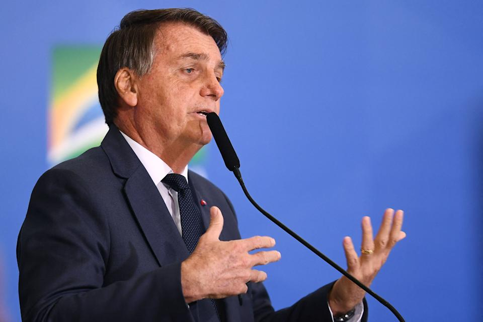 Brazilian President Jair Bolsonaro delivers a speech during the signing ceremony of the Provisional Measure that changes the rules for fuel trade, at Planalto Palace in Brasilia, on August 11, 2021. - Bolsonaro questioned once again the reliability of the upcoming elections in Brazil, a day after Congress rejected a proposal to alter the electronic voting system that he criticizes, and added that the bill was not approved because part of the lawmakers had been blackmailed, but did not give further details. (Photo by EVARISTO SA / AFP) (Photo by EVARISTO SA/AFP via Getty Images)
